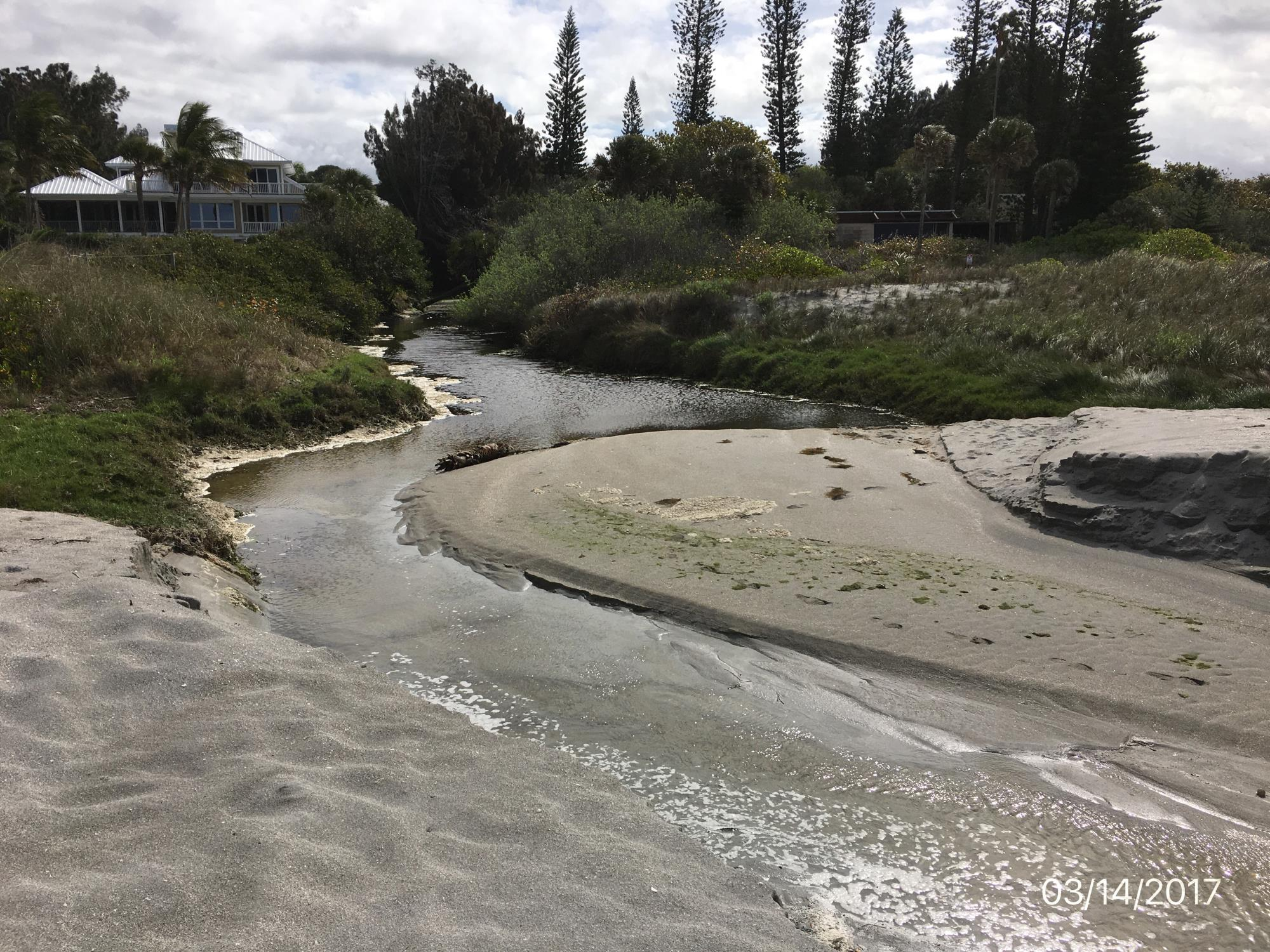 Outfall with stormwater flowing to the ocean