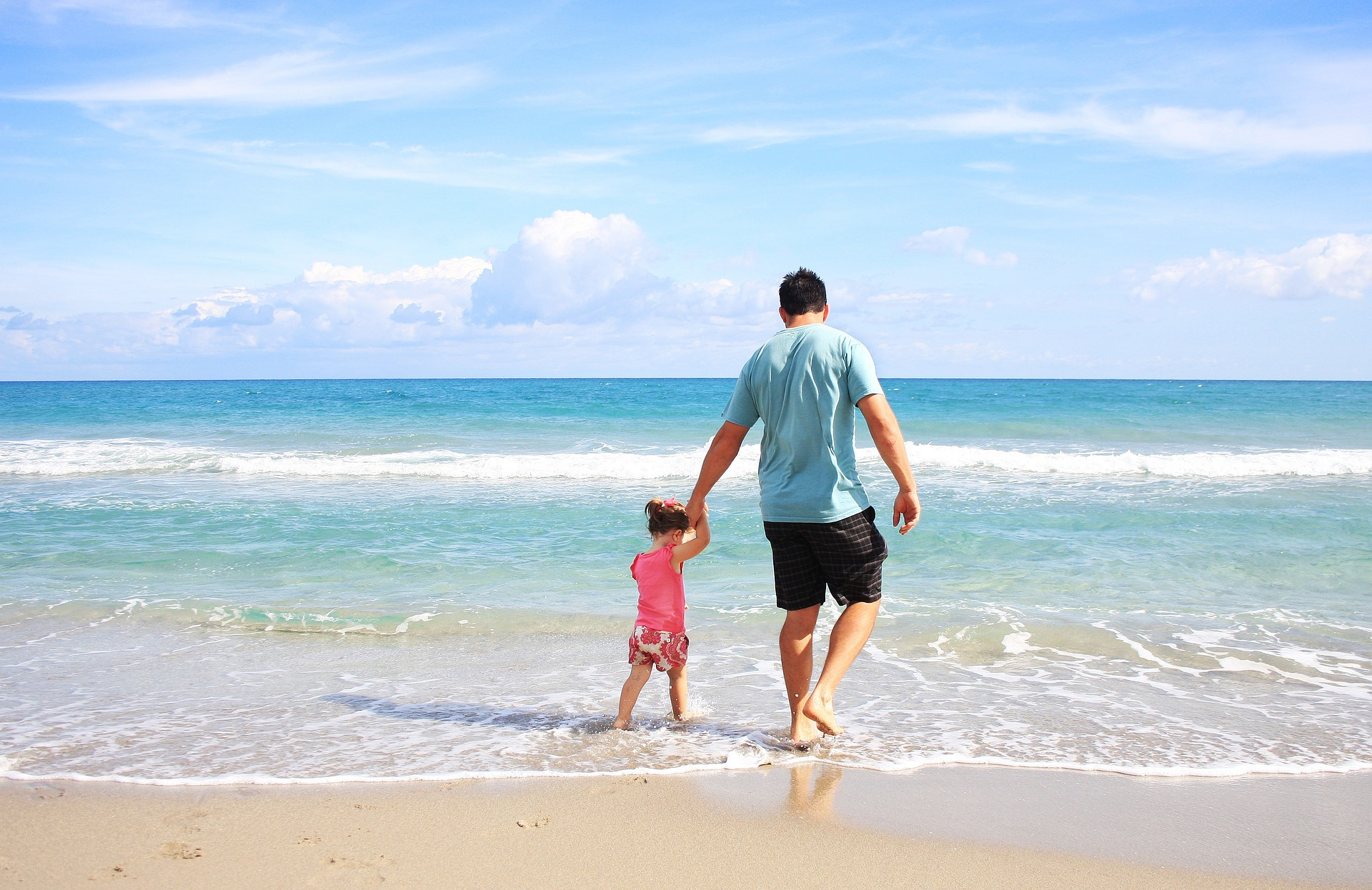 photo of father and daughter at beach