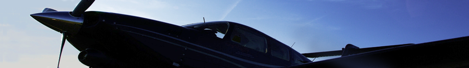 Silhouette of a Propeller Airplane